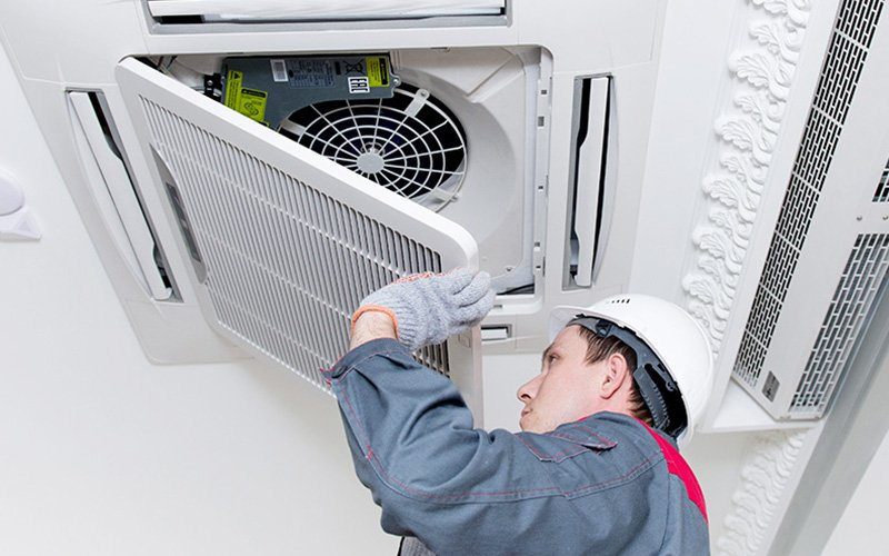 air conditioning unit being serviced