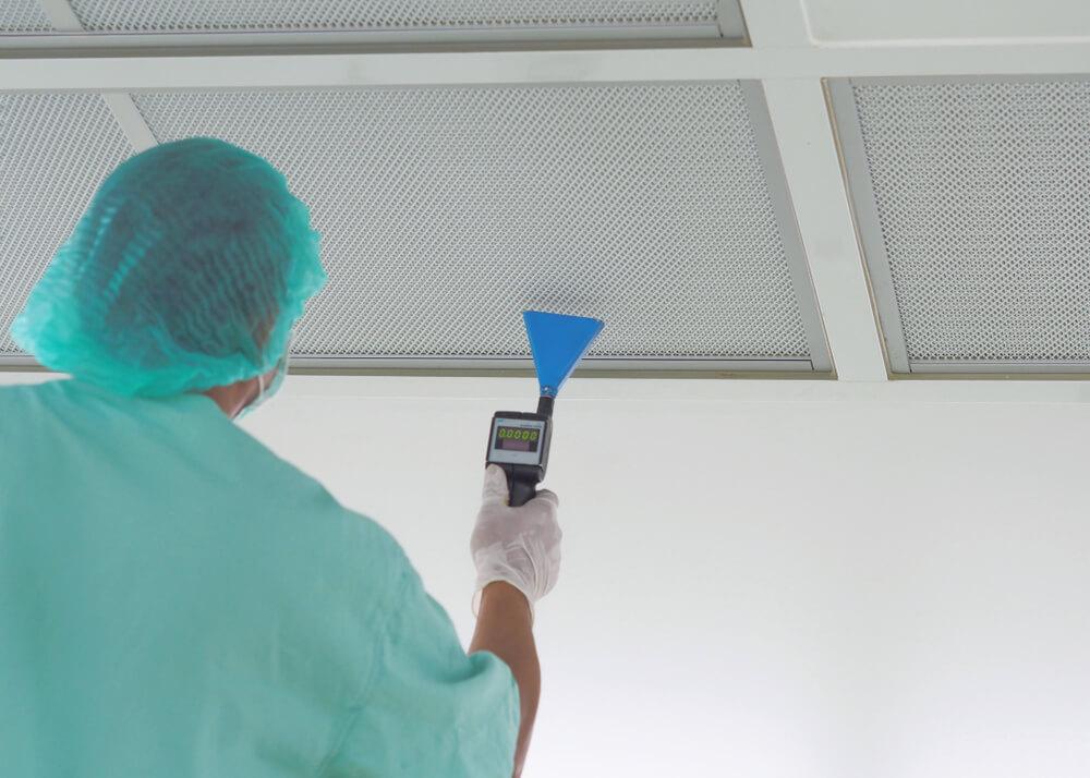 Technician is scanning leak on HEPA Filter in cleanroom