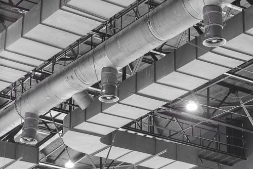 industrial ventilation system on the ceiling of an industrial building