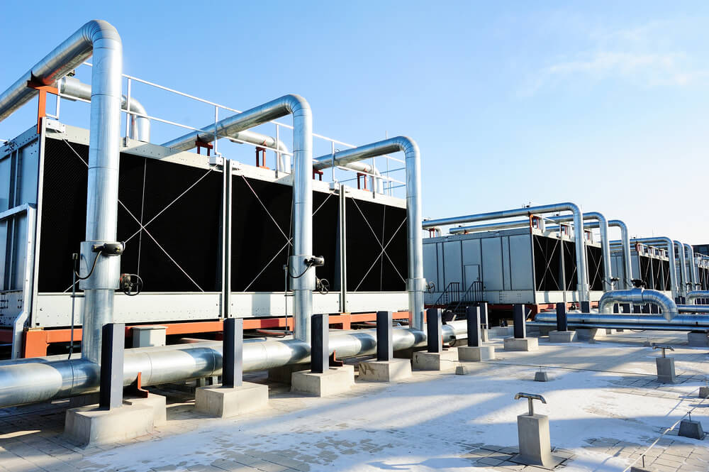 a Set of cooling tower units on the roof of a data center building.
