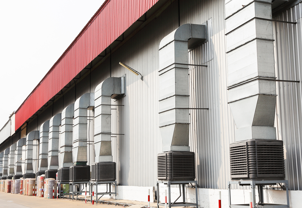 evaporative coolers on a commercial building rooftop